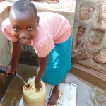 The Water Project: Nyira Community, Ondiek Spring -  Anita Andisi Drawing Water With Ease