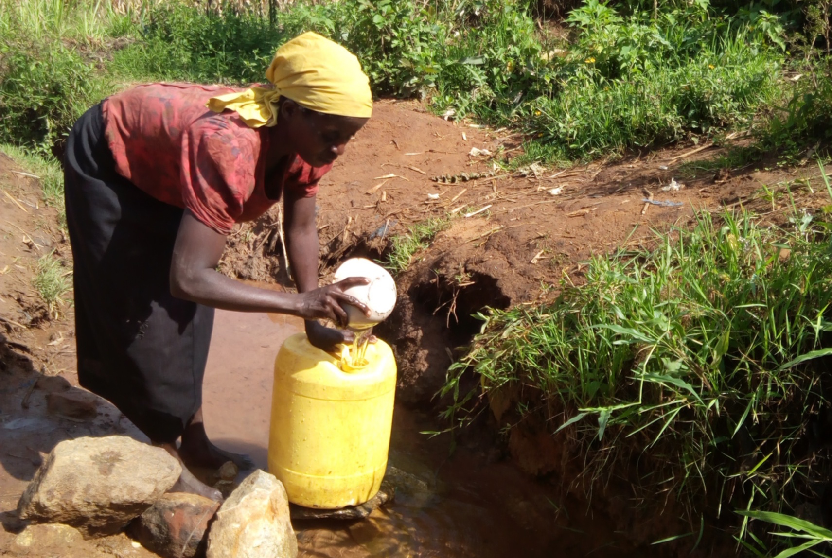 The Water Project : 1-kenya4856-lady-fetching-water-at-the-spring-2