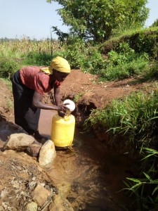 The Water Project : 1-kenya4856-lady-fetching-water-at-the-spring