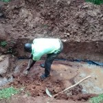The Water Project: Wamuhila Community -  Artisan Excavating The Spring