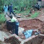 The Water Project: Wamuhila Community -  Covering The Walls During Rain