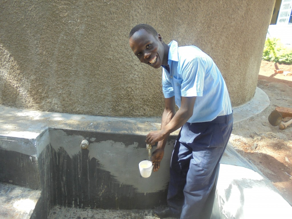 The Water Project : 13-kenya4651-filling-containers-with-clean-water