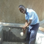 The Water Project: Digula Secondary School -  Filling Containers With Clean Water