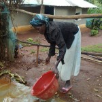 The Water Project: Wamuhila Community -  Rebecca Sayo Demonstrates How Easy It Is To Clean The New Sanitation Platform