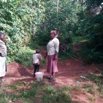 The Water Project: Gidagadi Community -  Community Members By The Spring