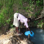 The Water Project: Luyeshe Community -  Jecinta Filling Her Jerrycan
