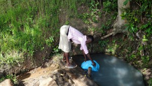 The Water Project:  Jecinta Filling Her Jerrycan