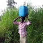 The Water Project: Luyeshe Community -  Jecinta Carrying Water