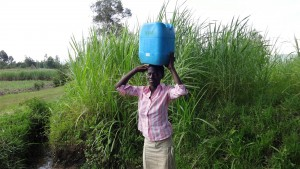 The Water Project:  Jecinta Carrying Water