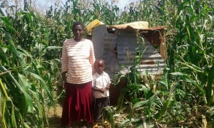 The Water Project:  Consolata And Her Son By Their Latrine