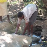 The Water Project: Chepkemel Community -  Fetching Water
