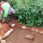 The Water Project: Wamuhila Community -  Alice Imali Helping The Artisan To Set The Place For Casting Her Latrine Slab