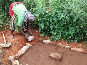 The Water Project:  Alice Imali Helping The Artisan To Set The Place For Casting Her Latrine Slab