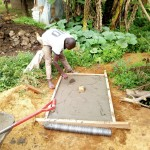 The Water Project: Chegulo Community, Shakava Spring -  Sanitation Platform Construction