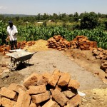 The Water Project: Kalenda Primary School -  Artisans Working On Latrine Foundation