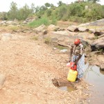The Water Project: Kithuluni Community -  Fetching Water