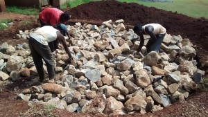 The Water Project:  Stones Arranged For Tank Foundation