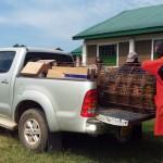 The Water Project: Ibinzo Girls Secondary School -  Community Members Helping Unload A Truck