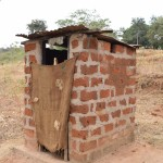 The Water Project: Ilinge Community C -  Janet Mbatha Latrine