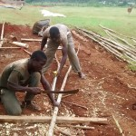The Water Project: Ebukanga Secondary School -  Men Make Poles To Support Dome Construction