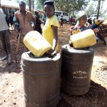 The Water Project: Walodeya Primary School -  Helpig Fetch Water For Construction