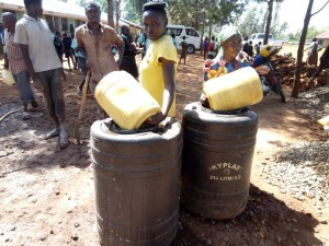 The Water Project:  Helpig Fetch Water For Construction