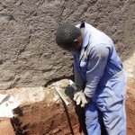 The Water Project: Ebukanga Secondary School -  Artisan Installing Discharge Pipe