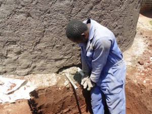 The Water Project : 16-kenya4667-artisan-installing-discharge-pipe