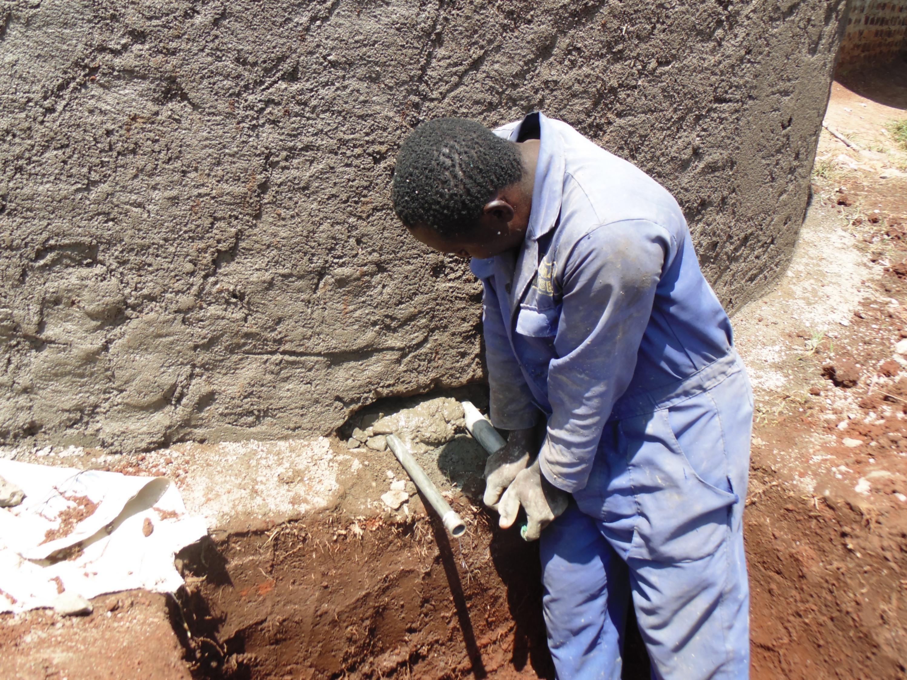 16 kenya4667 artisan installing discharge pipe