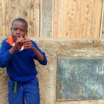 The Water Project: Essunza Primary School -  Student Posing At Latrines