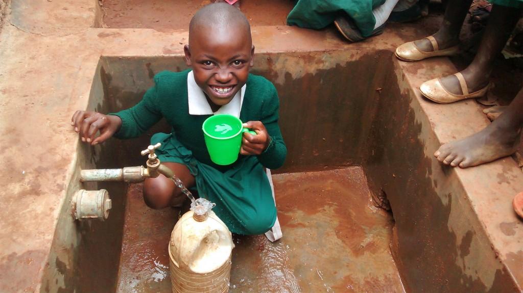 The Water Project : 21-kenya4668-anastacia-ogutu-enjoys-water-at-the-tank