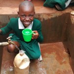 The Water Project: Emurembe Primary School -  Anastacia Ogutu Enjoys Water At The Tank