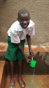 The Water Project:  Austine Makata Enjoying The Fresh Water From The Tank