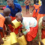 The Water Project : 24-kenya4674-students-cleaning-their-containers