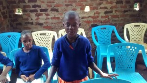 The Water Project : 4-kenya4674-student-responding-to-a-question-in-training