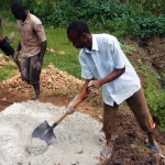 The Water Project: Bushevo Community -  Mixing Cement
