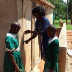 The Water Project: Emurembe Primary School -  Girls Learning About Latrine Use