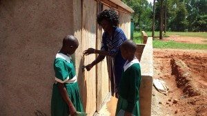 The Water Project:  Girls Learning About Latrine Use