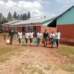 The Water Project : 6-kenya4683-students-coming-back-to-school-with-water