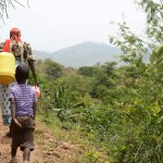 The Water Project: Kithuluni Community -  Carrying Water