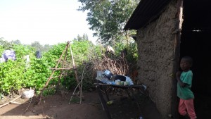 The Water Project : 6-kenya4853-victor-outside-his-parents-house