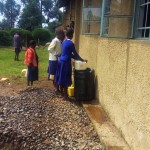 The Water Project: Musudzu Primary School -  Students Fetching Water For Construction