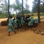 The Water Project: Eshilakwe Primary School -  Children Helping Carry Stones