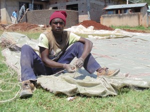 The Water Project : 8-kenya4667-community-member-alex-helps-sew-sugar-sacks