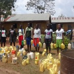 The Water Project: Emukangu Primary School -  Community Members Fetching Water For Construction