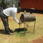 The Water Project : 8-kenya4683-deputy-principal-using-the-staff-hand-washing-station
