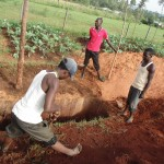 The Water Project: Ebukanga Secondary School -  Community Members Sinking Pit For Latrines