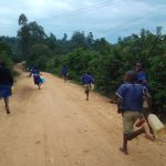 The Water Project: Iyenga Primary School -  Rushing To Fetch Water