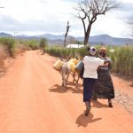 The Water Project: Karuli Community C -  Kimanzi Household Off To Fetch Water