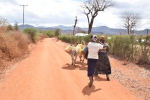 The Water Project:  Kimanzi Household Off To Fetch Water